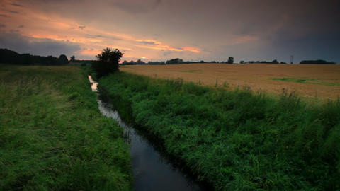 Static shot of a stream and a wide field in Copenhagen, Denmark Footage