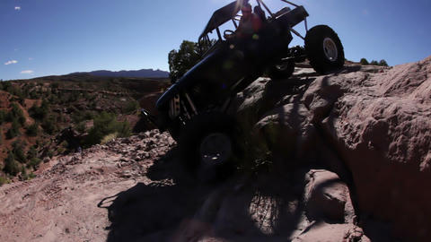 Driving Down off a Steep Ledge in Moab, Utah Footage