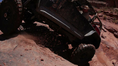 Jeep unsuccessful at climbing up a cliff Live Action