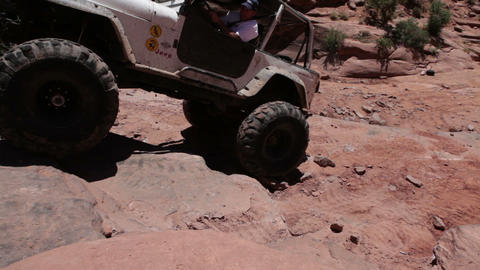 White Jeep Climbing Rocks Live Action