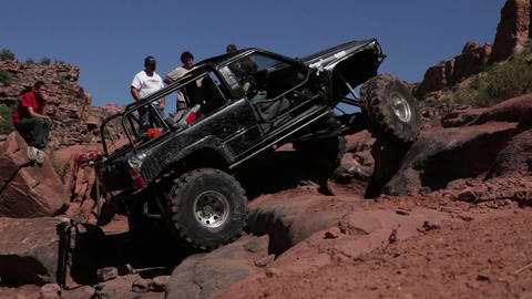 Black jeep spins tires Footage
