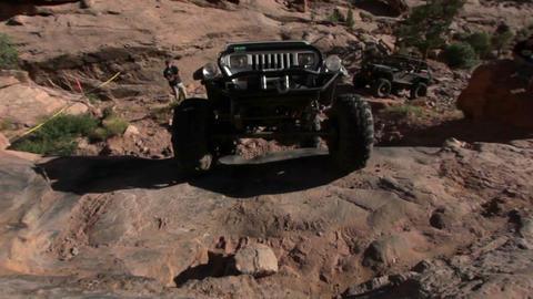 Jeep drives toward camera Footage