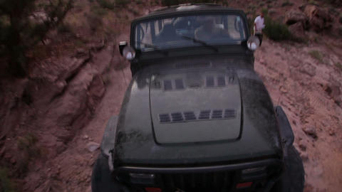 Man Driving Jeep up Rocks Live Action