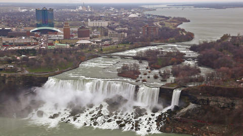 American Falls and Bridal Veil Falls at Niagara Falls with New York in the backg Footage