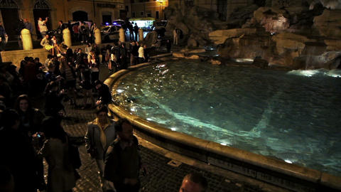 Tourists gather around the illuminated Trevi Fountain at night circa May 2012 in Footage