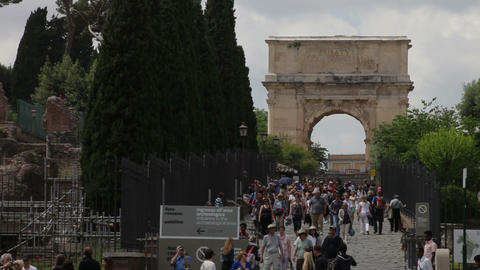 View of Arch of Titus and tourists seen walking near the Colosseum Footage