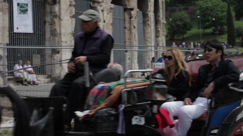 Horse carriage with tourists pulled on street in front of the Colosseum Footage