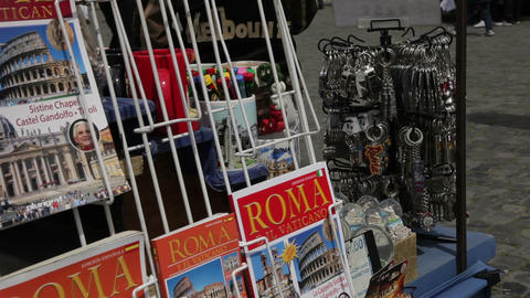 History, tourism, and guide books at souvenir spot at the Colosseum Footage