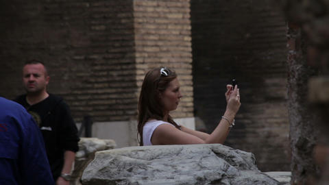 Tourists walking around taking pictures in the Colosseum in Rome, Italy Footage