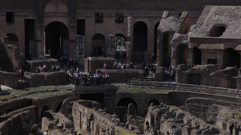 Tourists at the far side of the Colosseum seen from the upper balcony Footage