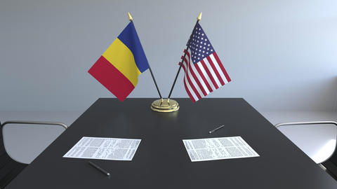 Flags of Romania and the United States of America and papers on the table Live Action