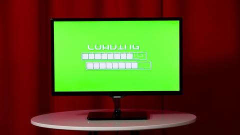 Flat screen TV. Standing on a white table. Green screen. Wait loading ビデオ