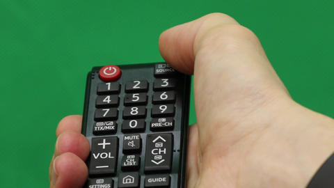 Men's hand. Large remote control. Right hand. Green screen. Press the button Footage