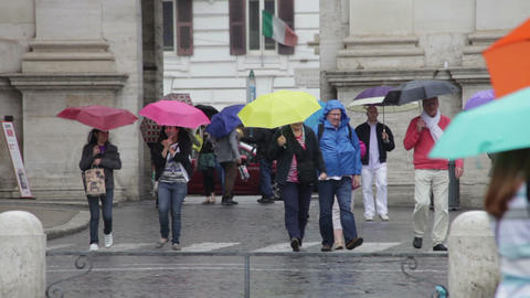 ROME - MAY 8 Tourists crossing roadway on a windy day Footage