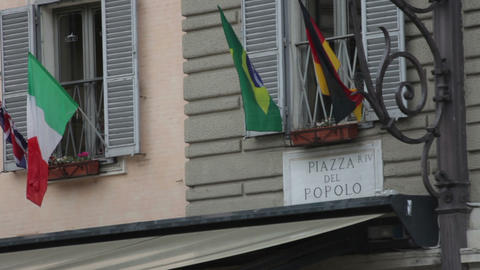 Sign titled Piazza Del Popolo above an awning Footage