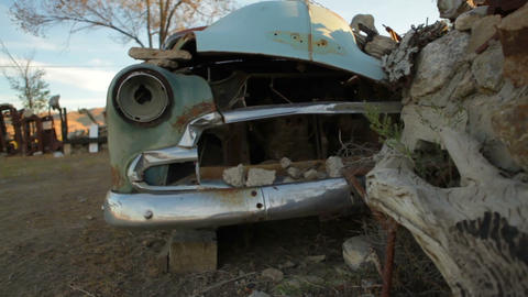 Old, rusted car at Thunder Mountain Park in Nevada Footage