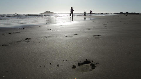 Three little girls running on beach Footage