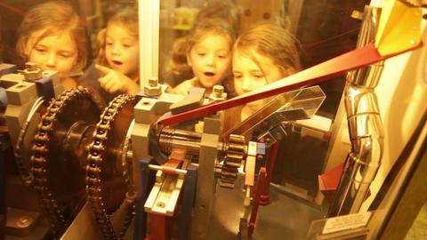 Children Watching Souvenir Penny Machine Footage