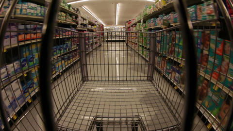 Time-lapse of a shopping cart moving down aisles Footage