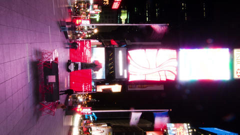 Vertical shot of Time lapse in Times Square with people walking around the plaza Footage