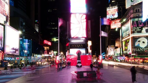 Panning shot of Time lapse in Times Square with people walking around the plaza Footage