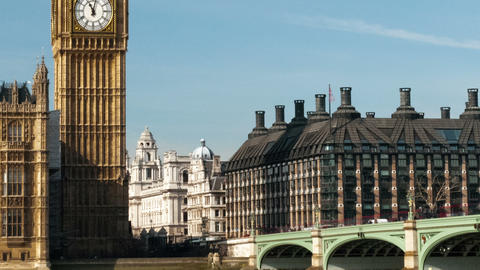 Panning shot of Traffic crosses London's Westminster Bridge in a time-lapse shot Footage