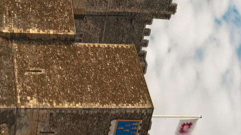 Vertical time-lapse of flags blowing over Dover Castle Footage