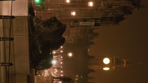 Vertical shot of Big Ben and a lion statue in a night time-lapse shot in London Live Action