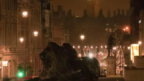 Panning shot of Big Ben and a lion statue in a night time-lapse shot in London Live Action