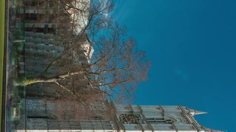 Vertical time-lapse of Westminster Abbey under a blue sky in London Footage