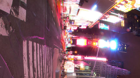 Vertical shot of Time lapse of Times Square at night Footage