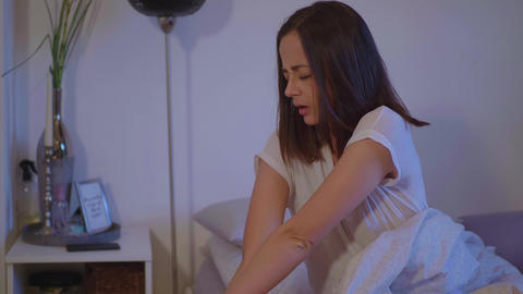 Young woman wakes up in the morning Footage