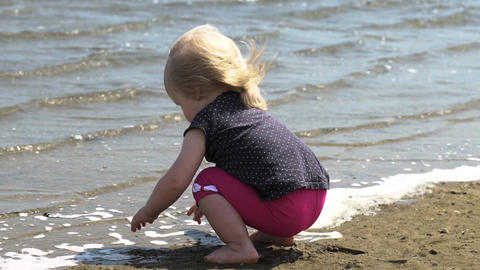 Ecstatic child by the lake. Little girl on nature. Unity with nature Footage