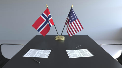 Flags of Norway and the United States of America and papers on the table Live Action