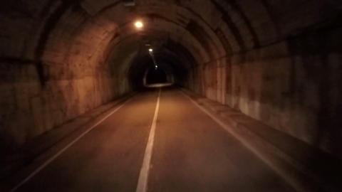 Driving through the tunnel road. POV. Darkness gloomy. Vertigo effect. Horror Footage