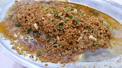 Motion of steamed codfish with savory crisbean and heavy steam inside Chinese Live Action