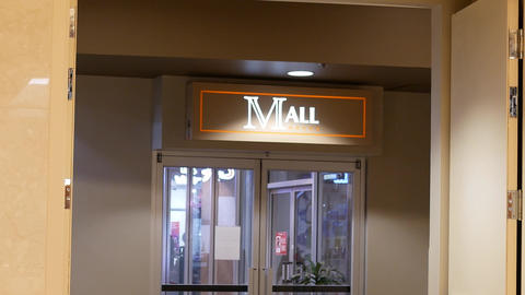 Motion of mall sign inside shopping mall with 4k resolution Live Action