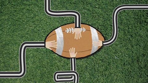 Long Hand Assembling a Football Cutout Retro Style Footage