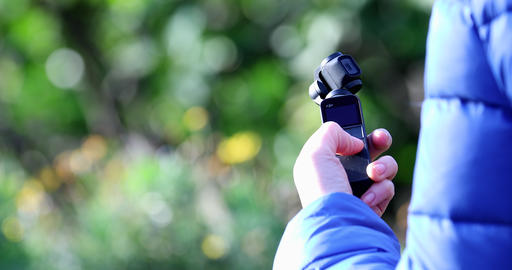 Woman Holding In Her Hand A DJI Osmo Pocket Gimbal Camera Live Action