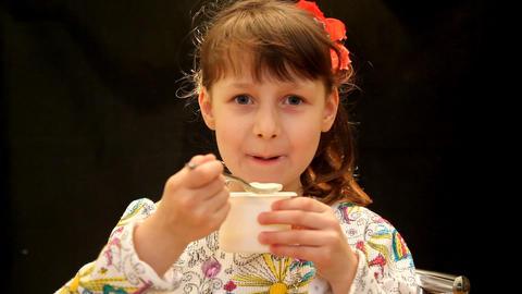child eats yogurt Stock Video Footage