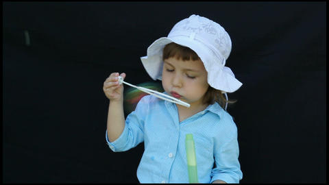 Girl blow bubbles Stock Video Footage