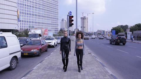 Sexy Fashion UFO Alien Couple Robotic Street Walking stock footage