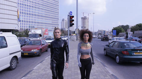 sexy fashion UFO alien couple robotic street walking Stock Video Footage