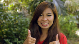 Young Woman Turning to Camera with Thumbs Up and a Smile Footage