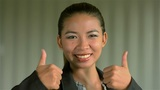 Young Businesswoman Giving A Smiling Thumbs Up To The Camera stock footage