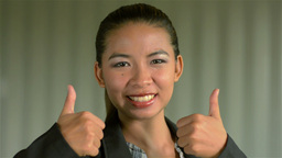Young Businesswoman Giving a Smiling Thumbs Up to the Camera Stock Video Footage