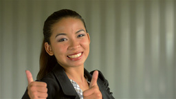 Young Asian Businesswoman Giving a Smiling Thumbs Up to... Stock Video Footage