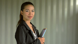 Young Asian Businesswoman Smiling at the Camera Footage