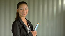 Young Asian Businesswoman Smiling at the Camera Stock Video Footage