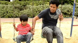 Father and Son on a Swing Stock Video Footage